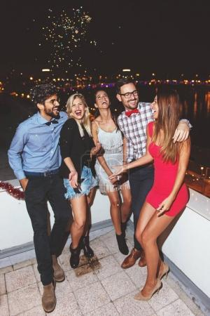 Group of people having a party on the roof