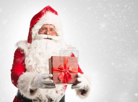 Photo for Santa Claus with gift  isolated on white background - Royalty Free Image