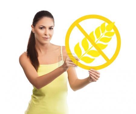 Beautiful, young woman holding a gluten free symbol