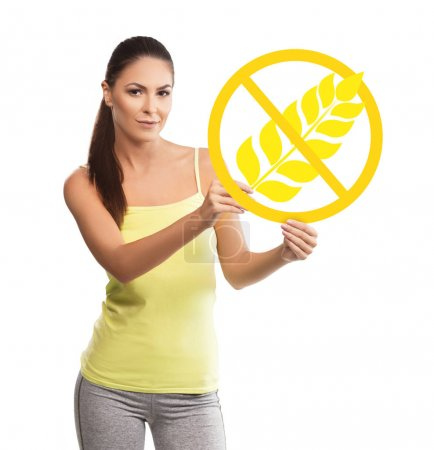 Beautiful, young woman holding a gluten free symbol