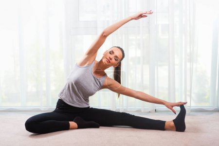 young Woman exercising in a bright room