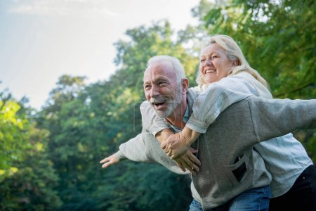 Photo for Happy senior couple having fun  outdoors in nature - Royalty Free Image