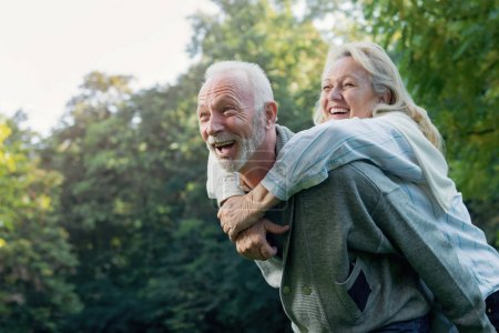 Happy senior couple having fun  outdoors in nature