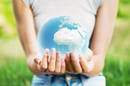 Woman holding planet Earth in her hands