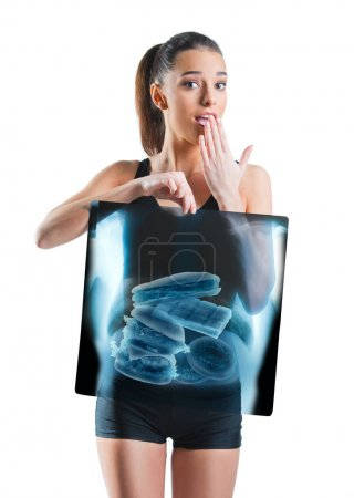 Fit, beautiful woman holding an x-ray of stomach