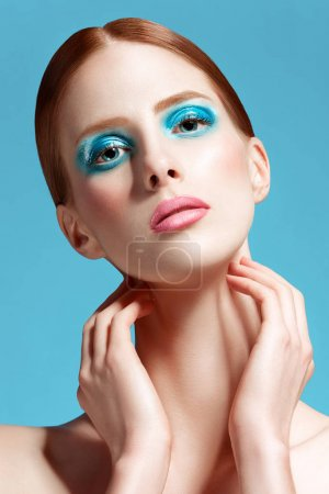 Beautiful woman close up, high-quality beauty on blue background