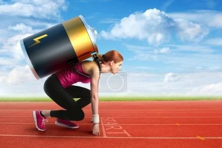 Photo for Woman preparing to run with a battery on her back - Royalty Free Image
