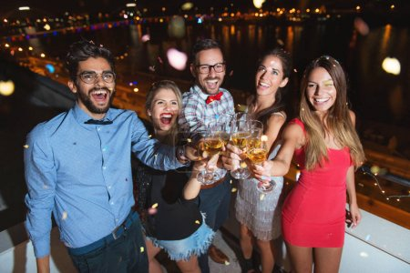 Photo for Group of people having a party, cheering with champagne - Royalty Free Image