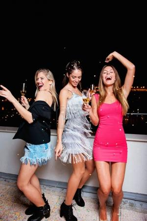 Three beautiful, cheerful women having a girls night out, having fun
