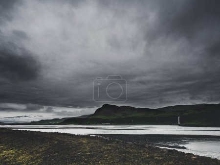 gloomy landscape with river and mountains in Iceland