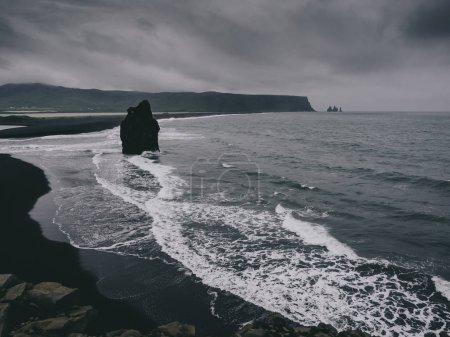 Black sand beach with rocks, Vik, Iceland