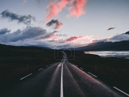 Photo for Landscape with beautiful sunset with clouds and road in Iceland - Royalty Free Image