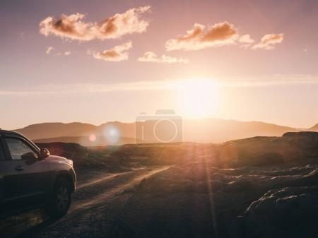 Photo for Majestic landscape with car on iceland road and beautiful sunset - Royalty Free Image