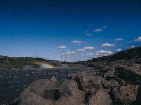 beautiful view of Dettifoss area with rocks and blue sky in Iceland