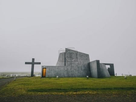 Photo for Modern church, concrete construction, with a large cross, new parish church, Bloendus, Blonduos, Iceland - Royalty Free Image