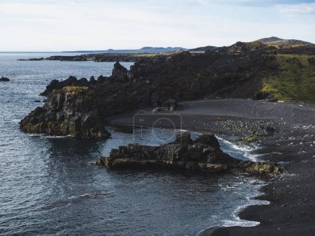 scenic view of coastline with dark cliffs, Dritvik Djupalonssandur, Iceland