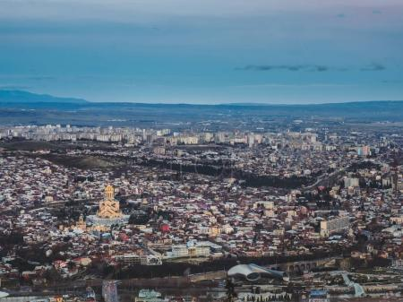 aerial view of city in Georgia and sky at sunset
