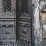 Close up view of wooden door of ancient building...