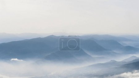 Photo for Scenic view of mountains in fog and sky - Royalty Free Image