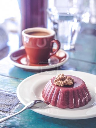 Photo for Close-up view of delicious dessert with walnuts, cup of coffee and glass of water on table - Royalty Free Image