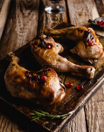 Photo for Close-up shot of delicious grilled chicken legs on wooden board - Royalty Free Image