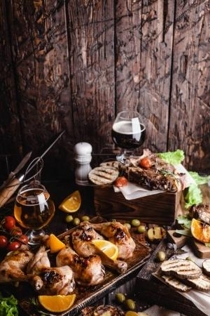 delicious grilled meat with vegetables and beer