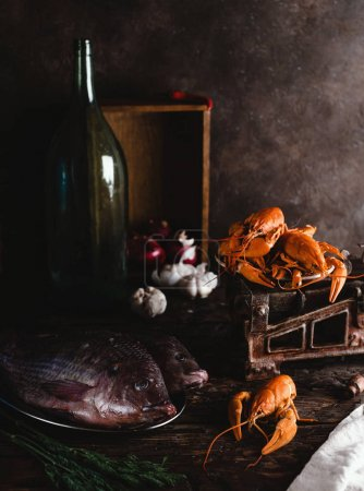 close-up view of fresh raw fish and lobsters on vintage scales