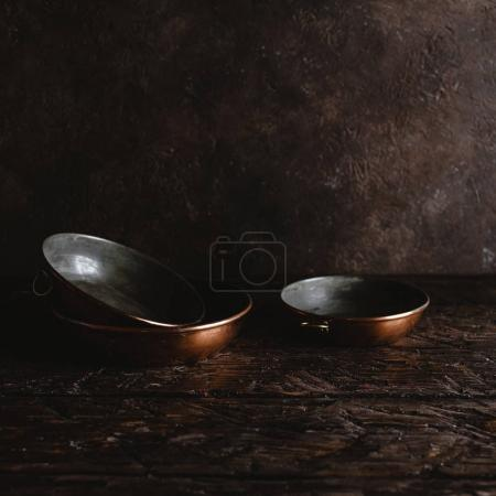 close-up view of arranged empty vintage utensils on rustic wooden table