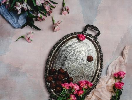 Photo for Top view of vintage tray with chocolate candies and pink roses on shabby background - Royalty Free Image