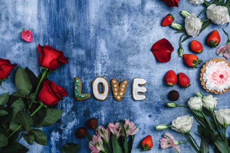 Photo for Top view of strawberries, chocolate candies, flowers and Love cookies for valentines day - Royalty Free Image