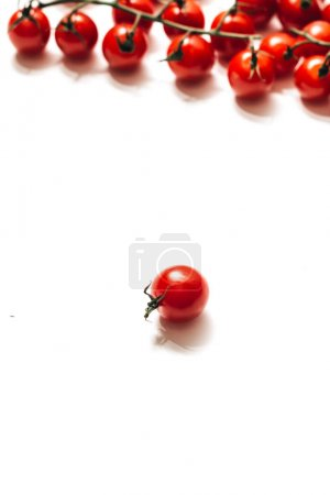 Photo for Raw ripe cherry tomatoes isolated on white background - Royalty Free Image