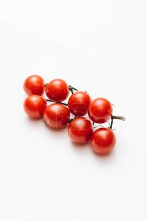 Photo for Branch of raw ripe cherry tomatoes isolated on white background - Royalty Free Image