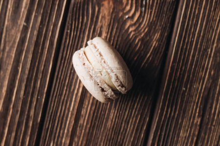 Photo for Delicious macaroon on wooden table, sweet dessert - Royalty Free Image