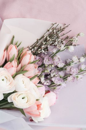 beautiful spring bouquet with tender ranunculus flowers and tulips, elegant floral decoration
