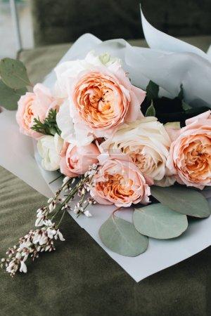 beautiful spring bouquet with tender pink ranunculus flowers, elegant floral decoration