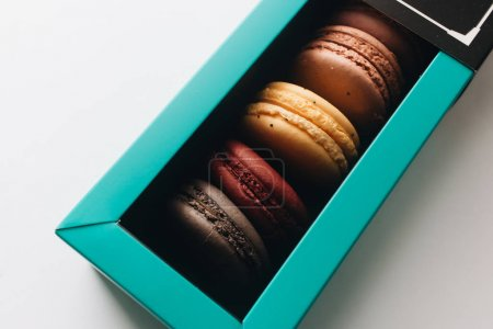 Photo for Box with delicious bright macaroons, sweet dessert - Royalty Free Image