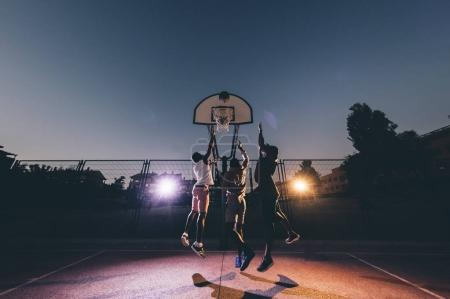 Africans play basketball on street courts