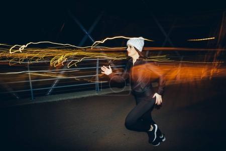 Long exposure beautiful woman running.