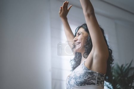 Photo for Woman performing abdominal hypopressive exercises - Royalty Free Image