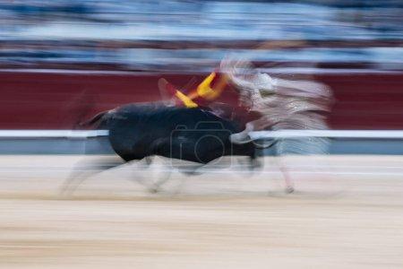 Long exposure man bullfighter dressed in bullfighting costume.