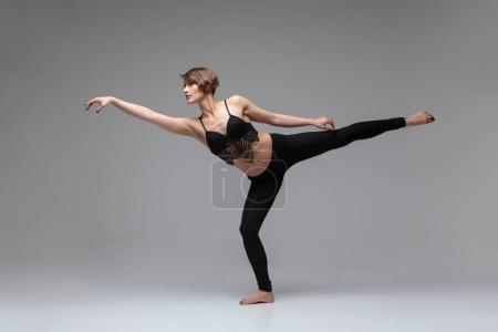Photo for Female dancer making modern dancing elements - Royalty Free Image