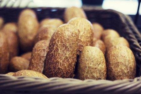 Lots of bread buns in a basket
