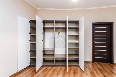 Modern wardrobe with opened doors