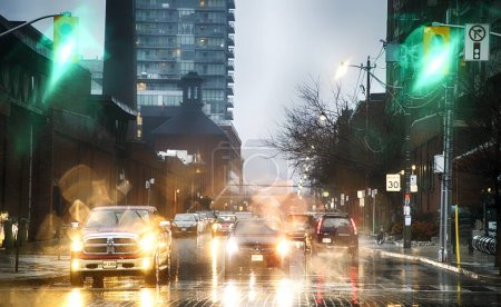Photo for Evening shot of traffic on street of modern city downtown - Royalty Free Image