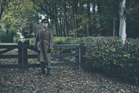 Retro military officer in forest