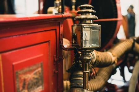lantern on old fire truck.