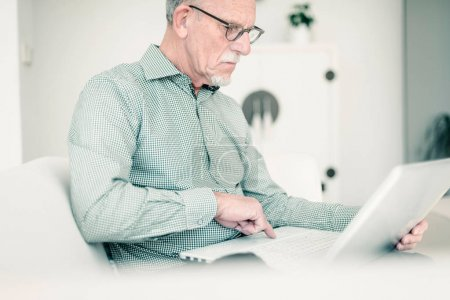 Senior man working with laptop