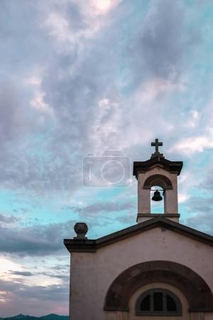 White church under cloudy sky