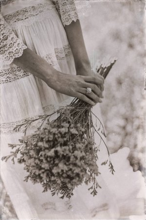 hands of bride holding flower bouquet
