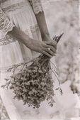hands of bride holding flower bouquet